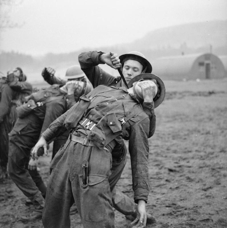 Commandos use fighting knives during close-quarter combat practice in Scotland, January 9, 1943. H 26613. Part of War Office Second World War Official Collection. War Office official photographer Lockeyear WT (Lt)