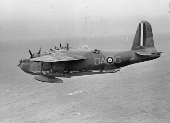 Short Sunderland Mark I, L2163 'DA-G', of No 210 Squadron RAF based at Oban, in flight over the Atlantic while escorting Canadian Troop Convoy 6 (TC.6), inbound for Greenock