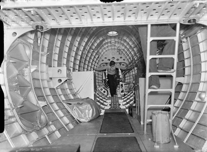 The rear fuselage interior of a Short Sunderland Mark I of No. 210 Squadron RAF, showing the tail gunner leaving his turret and making his way forward. CH 807 Part of AIR MINISTRY SECOND WORLD WAR OFFICIAL COLLECTION Devon S A (Mr) Royal Air Force official photographer